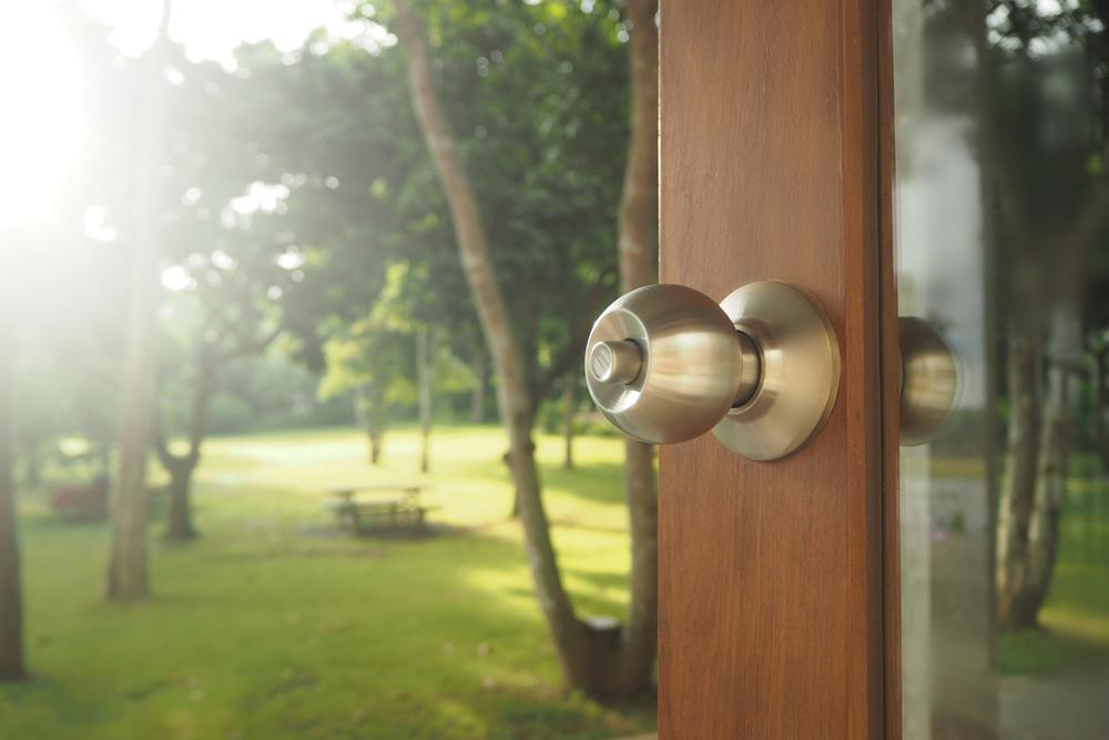 a door knob on a storm door