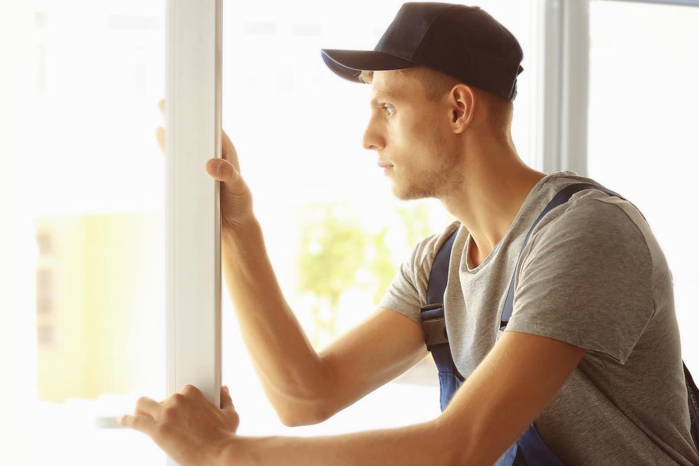 a man replacing a door that's been repaired